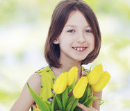 Girl with yellow tulips Royalty Free Stock Image