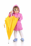 Girl with yellow umbrella Stock Photography