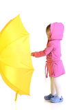 Girl with yellow umbrella Royalty Free Stock Photography