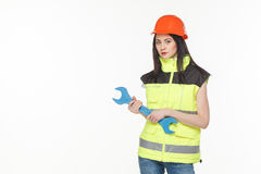Girl in a yellow vest with the tool. S white background Stock Photography