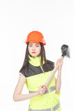 Girl in a yellow vest with the tool. S white background Royalty Free Stock Photo