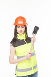 Girl in a yellow vest with the tool. S white background Royalty Free Stock Photography