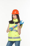 Girl in a yellow vest with the tool. S white background Stock Images