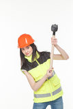 Girl in a yellow vest with the tool. S white background Stock Image