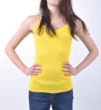 Girl in a yellow vest on white background. Girl in a yellow vest isolated on white background Royalty Free Stock Photos