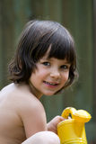 The girl with a yellow watering can. Portrait of the girl with a yellow watering can Stock Photos