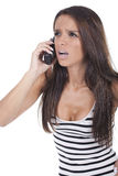 Girl yells on the phone Royalty Free Stock Image