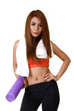 Girl with yoga accessory. Royalty Free Stock Image