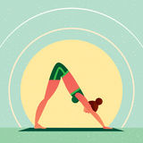 Girl in Yoga Downward-Facing Dog Pose Royalty Free Stock Image