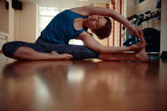 Girl in yoga gym Royalty Free Stock Image