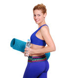 Girl with yoga mat and bottle of water Royalty Free Stock Photography