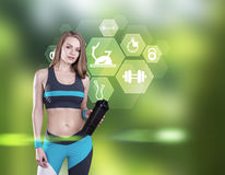 Girl with yoga mat and sport icons, forest Stock Images