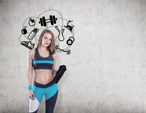 Girl with yoga mat and sport icons Royalty Free Stock Photography