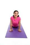 Girl in Yoga Pose. Girl Doing Yoga Pose in a Studio Stock Photo