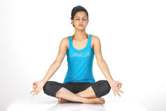 Girl  in yoga pose. Slim girl sitting in yoga pose Royalty Free Stock Images