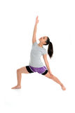 Girl in Yoga Pose. Girl Doing Yoga Pose in a Studio Stock Photo