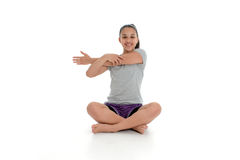 Girl in Yoga Pose. Girl Doing Yoga Pose in a Studio Stock Images