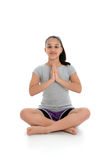 Girl in Yoga Pose. Girl Doing Yoga Pose in a Studio Royalty Free Stock Photo