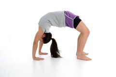 Girl in Yoga Pose. Girl Doing Yoga Pose in a Studio Stock Image