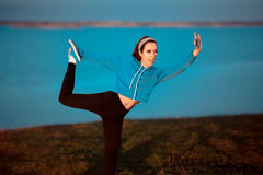 Girl in Yoga Pose Taking a Selfie Outside in Nature Royalty Free Stock Photo