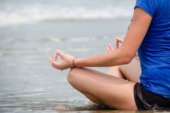 Girl in yoga pose. By the water Royalty Free Stock Photo