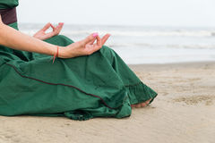 Girl in yoga pose. By the water Stock Photography