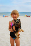 Girl with yorkshire dog on the beach Stock Image