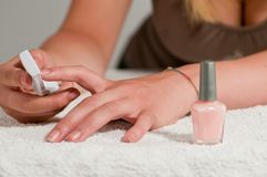 Girl you file your nails Royalty Free Stock Photos