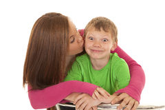 Girl and young boy kissed funny face Stock Photos