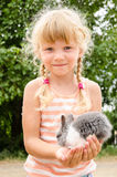 Girl with young bunny rabbit Royalty Free Stock Images