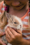 Girl with young bunny rabbit Stock Photo