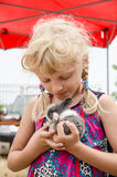 Girl with young bunny rabbit Stock Image