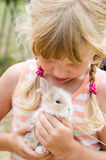 Girl with young bunny rabbit Stock Photography