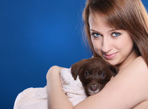 Girl with young dog Stock Photo
