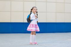 The girl is a young fashionista posing. royalty free stock images