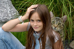 Girl and young kitten Royalty Free Stock Images