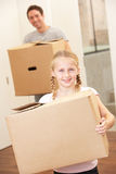 Girl with young man on moving day Royalty Free Stock Photos