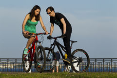 The girl and the young man ride on a bicycle in the city Stock Photo