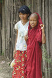 Girl and young monk Stock Photos