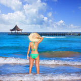 Girl young standing looking at the sea beach hat Stock Images