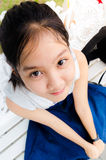 Girl young teen. Thailand girl young teen  sitting and looking up Stock Photography
