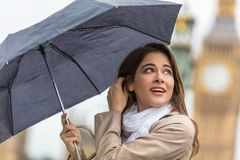 Woman Tourist With Umbrella by Big Ben, London, England royalty free stock images