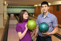 Girl and youth stand with balls for bowling Stock Photos