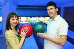 Girl and youth turned to each other with balls. Girl and youth turned to each other and adjoin balls for bowling Stock Photography