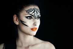 Girl zebra. Attractive young girl with make-up of wild zebra close-up portrait Royalty Free Stock Photography