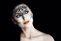 Girl zebra. Attractive young girl with make-up of wild zebra close-up portrait Royalty Free Stock Photos