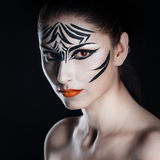 Girl zebra. Attractive young girl with make-up of wild zebra close-up portrait Royalty Free Stock Photo