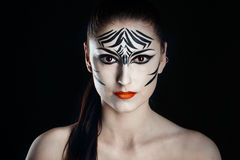 Girl zebra. Attractive young girl with make-up of wild zebra close-up portrait Stock Image