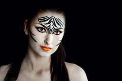 Girl zebra. Attractive young girl with make-up of wild zebra close-up portrait Stock Photography