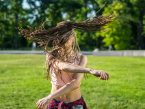 Girl with zizi cornrows dreadlocks dancing on lawn Royalty Free Stock Images